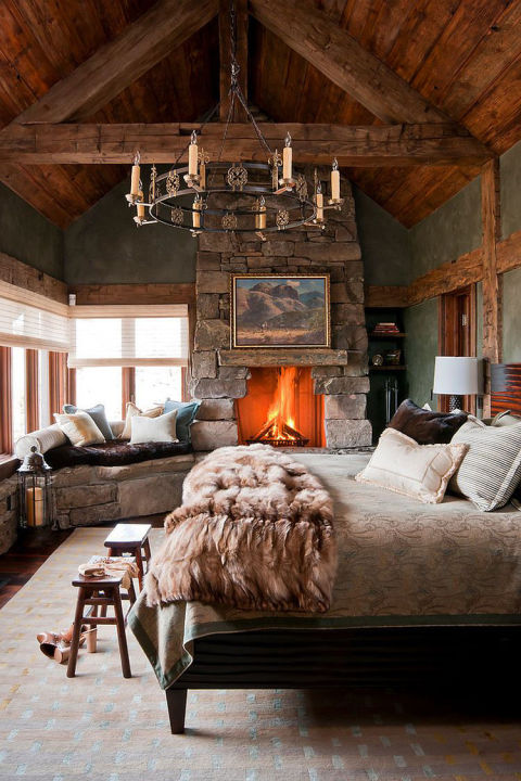 Gallery-1483727768-1482943287-syn-clg-lovely-stone-wall-fireplace-and-window-seat-enhance-the-woodsy-cabin-style-of-the-bedroom