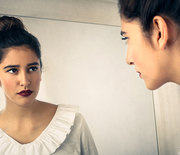 Thumb_woman-looking-mirror-1000