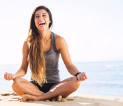 Thumb_woman-meditating-beach