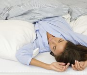 Thumb_woman-sleeping-bed-back