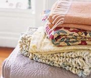 Thumb_quilts-piled_300
