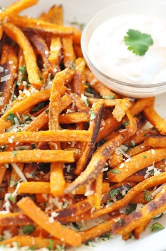 Baked-sweet-potato-french-fries-with-parmesan-cilantro-and-skinny-sriracha-dip-332x500