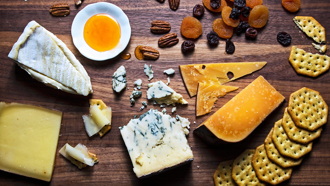 Hero-thanksgiving-cheese-board-entertaining-appetizers-fruit-crackers-cheese-meat-snacks-holidays-brie-blue-manchego-cheddar