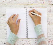 Thumb_1000-woman-writing-in-journal