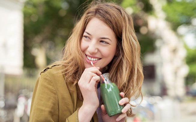 Woman-drinks-juice-small-bottle.jpg.653x0_q80_crop-smart